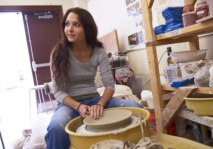 woman working with pottery