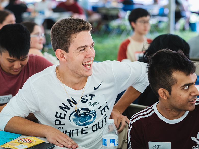 student laughing at an event