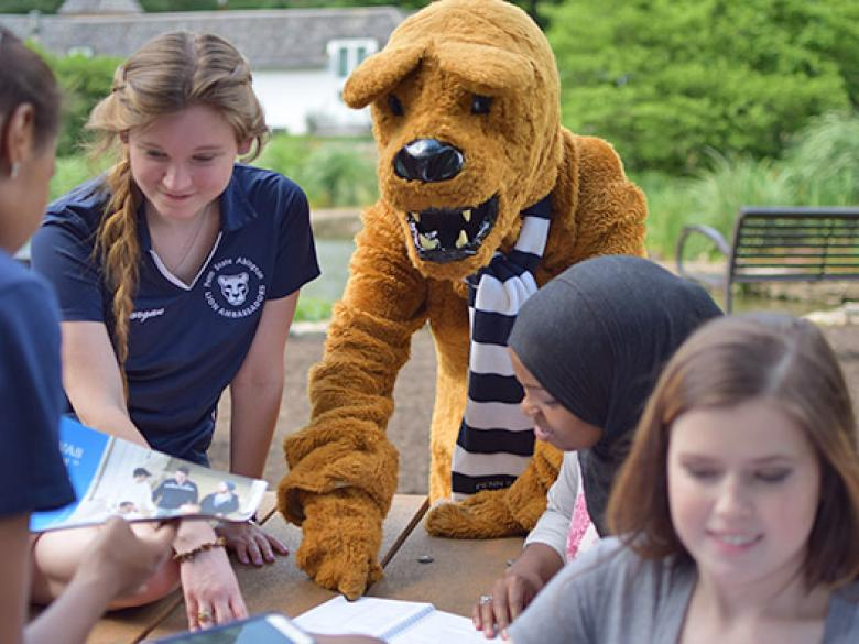Lion helping students at the pond