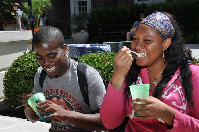 two students eating ice cream and smiling