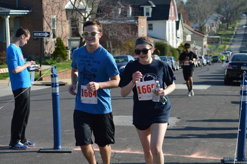male and female running in a 5k race