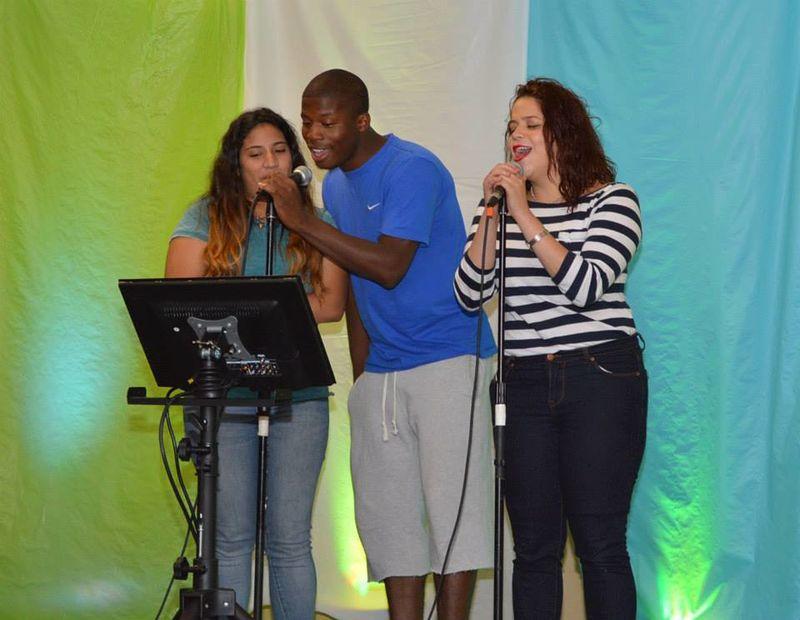 3 students singing karoake