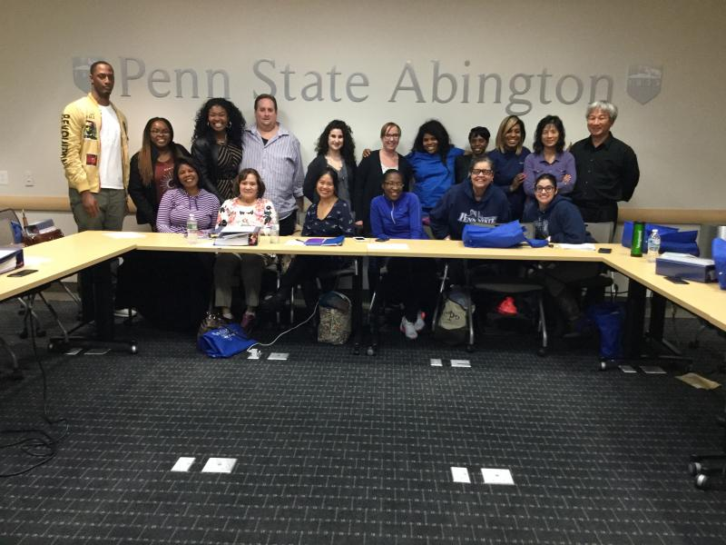Group of students posing for picture in front of Penn State Abington sign