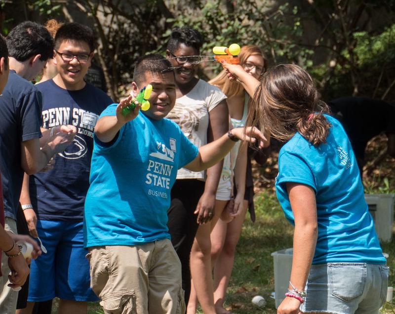 students shooting water guns at eachother